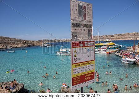 October 8th, 2016, Blue Lagoon Bay, Comino Island, Malta - Signs At The Famous Sea Lagoon And People