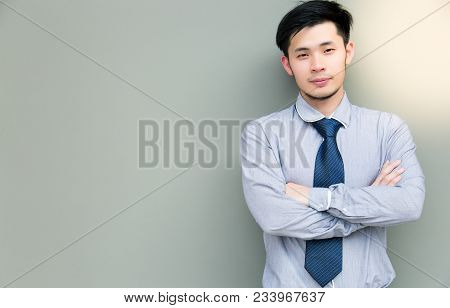 Portrait Charming Handsome Confident Businessman: Attractive Guy Crossed His Hands And Looks Determi