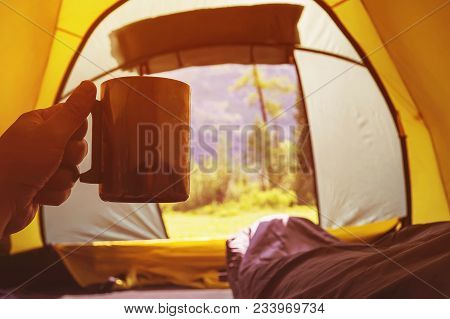 Traveling And Spending Time In Tent While Drinking Coffee In The Morning. View From Inside. Camper H