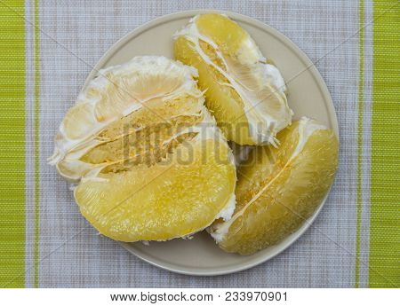 Purified Pomelo Lying In A Gray Plate
