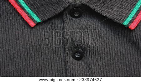 Black Polo Shirt Collar With Red And Green Lines Close Up View. Stylish Buttoned Shirt, Simple Casua
