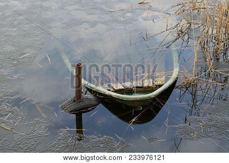 Sunken Rowing Boat In A Lake Near Magdeburg In Germany