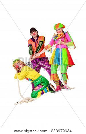 Three Smiling Clowns With Rope Isolated On The White Background
