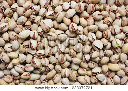 Pistachio Nuts In Shell Textured Background. Pile Of Fresh Green Roasted And Salted  Pistachios Top