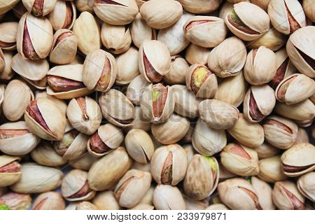Pistachio Nuts Texture Background Top View. Pile Of Fresh Green Pistachios, Roasted And Salted In Sh