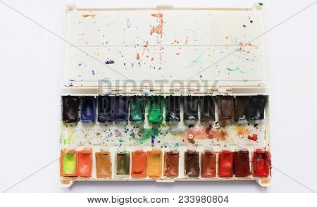 Paints Palette Isolated On White Background Top View. Colorful Used Open Aquarelle Watercolor Palett