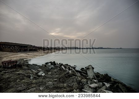 Beautiful Landscape Of Abandoned House On Rocky Seashore At Sunset Time. Cloudy Weather. Caspian Sea