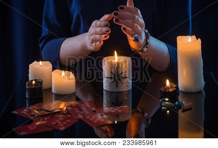The Divination With The Cards And The Candles