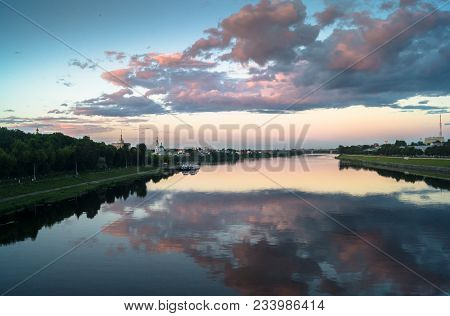 Mesmerizing summer evening landscape. Boundless expanse. Mirror glossy surface of the Volga river re