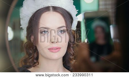 Young Woman Brunette In A Beauty Salon Posing For Camera - Close Up Shot