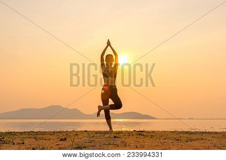 Healthy Good.  Meditation Yoga Lifestyle Woman Silhouette On The River Sunset, Relax Vital. Healthy