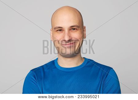 Bald Guy Smiling Isolated On Gray