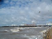 blackpool pier and stormy sea with seagulls poster