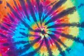 Bright colored tie dye design on fabric. poster