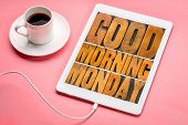 Good Morning Monday word abstract - text in vintage letterpress wood type printing blocks on a digital tablet with a cup of coffee poster