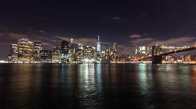 Manhattan Skyline And Brooklyn Bridge At Night
