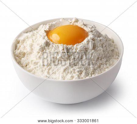 Bowl Of Flour And Egg Yolk Isolated On White Background