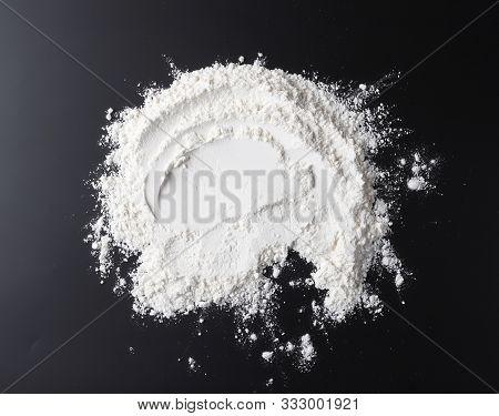 White Flour On Black Background, Top View