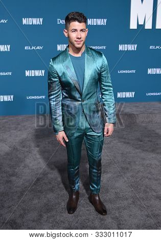 LOS ANGELES - NOV 05:  Nick Jonas arrives for the 'Midway' World Premiere on November 05, 2019 in Westwood, CA