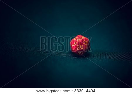 Old Damaged 20 Sided Die With 20 Face The Camera