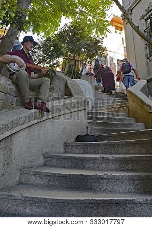 Istanbul, Turkey - September 8th 2019. A Busker Plays A 12 String Cumbus For Passersby On The Art No