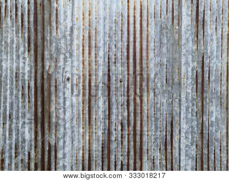 Old Rusty Galvanized, Corrugated Iron Siding Texture Background.a Rusty Corrugated Iron Metal Textur