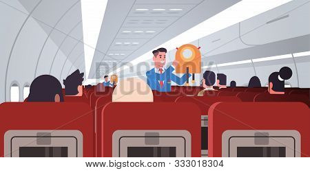Steward Explaining For Passengers How To Use Jacket Life Vest In Emergency Situation Male Flight Att