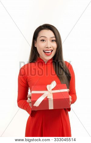 Portrait Of Beautiful Asian Woman In Vietnamese Traditional Dress Holding A Gift