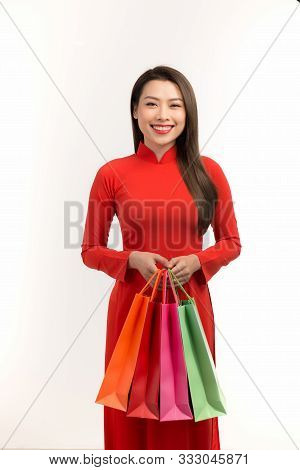 Beauty Women Wear Ao Dai And Take Shopping Bag In Lunar New Year (tet Holiday)