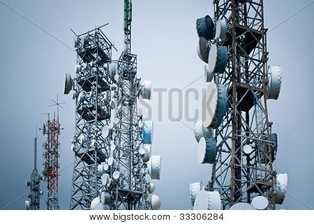 many telecommunications towers in a unreal scenery poster