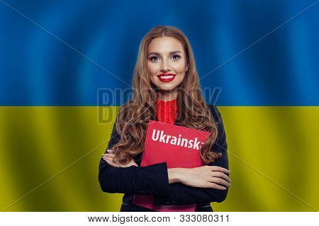 Ukraine Concept. Pretty Smiling Brunette Woman Against The Ukrainian Flag Background. Travel In Ukra