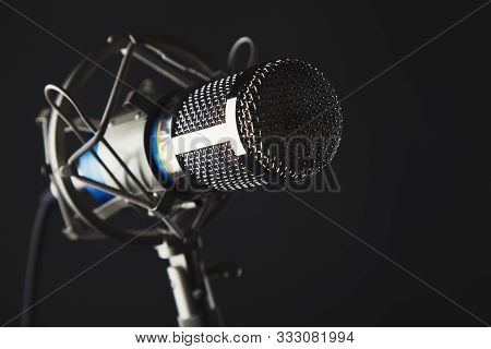 Metal Body Microphone On Dark Grey  Background Studio Shot