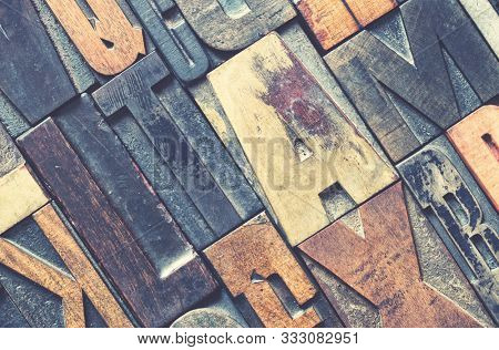 Detail of wood letterpress printing blocks with retro style processing