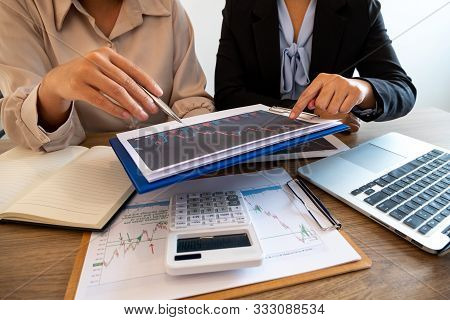 A Team Of Business Executives Are Planning Consultations About Business Investments Related To Share