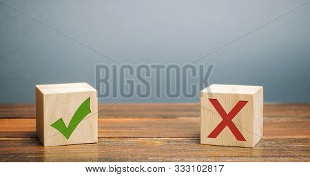 Wooden Blocks With A Green Check Mark And Red X. The Concept Of Choice And Making The Right Decision