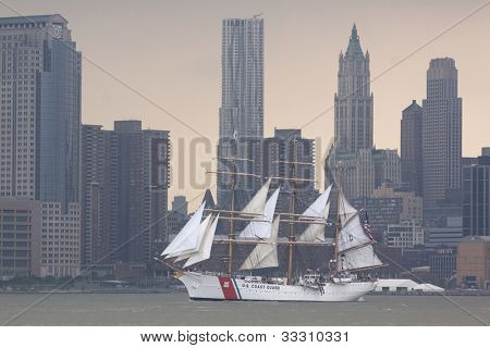 HOBOKEN, NJ - MAY 23: The USCGC Eagle (WIX 327) sails on the Hudson River past Manhattan during the Parade of Sail on May 23, 2012 in Hoboken, NJ. The parade is the start of Fleet Week.