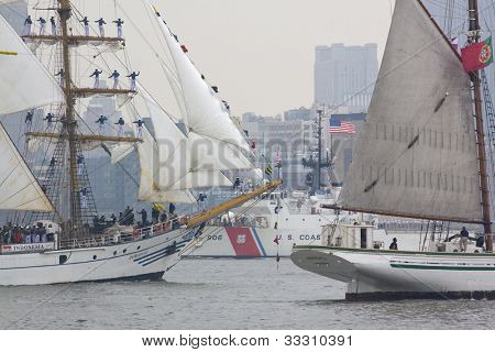 HOBOKEN, NJ - MAY 23: USCGC Seneca (WMCE 906) sails past two tall ships on the Hudson River during the Parade of Sail on May 23, 2012 in Hoboken, NJ. The parade is the start of Fleet Week.