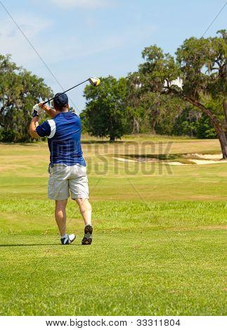 Golfer With A Good Tee  Shot