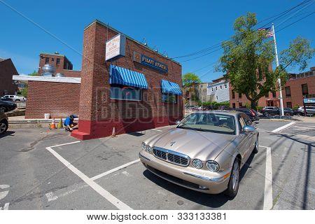 Gloucester, Ma, Usa - Jun. 3, 2018: Historic Commercial Buildings And Antique Jaguar Car On Rogers S