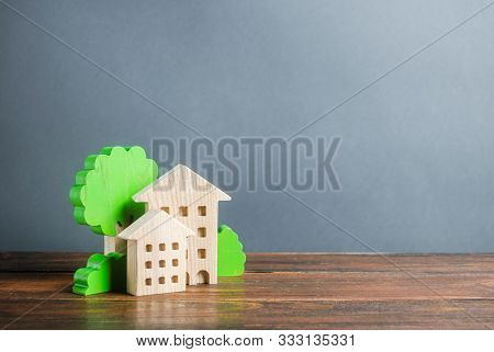 Figures Of Houses And Trees. Affordable Comfortable Housing. Purchase Of Apartments And Real Estate,