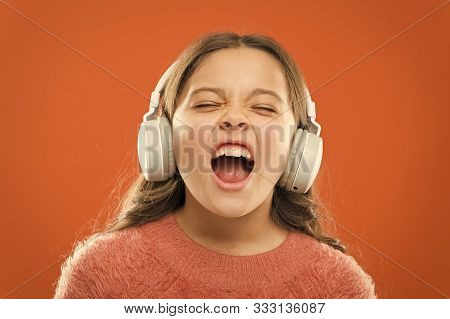 For Better Vocal Performances. Adorable Small Child Doing Vocal On Song. Little Girl Listening To Mu