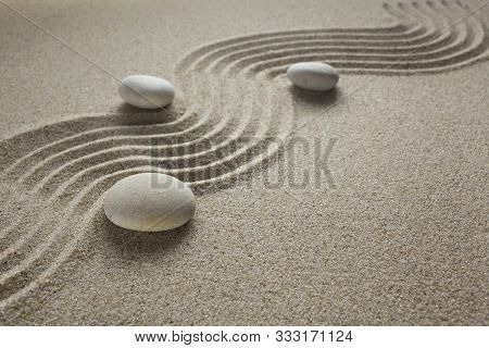 Zen Garden Stones In Light Sand For Relaxation And Concentration During Meditation