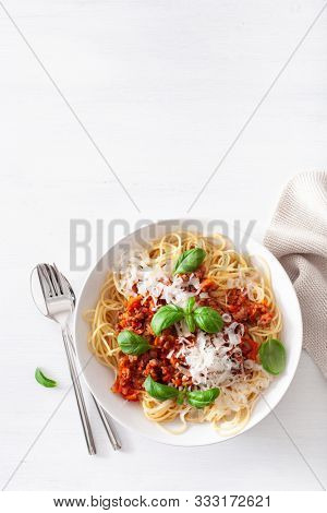 spaghetti bolognese with basil and parmesan, italian pasta