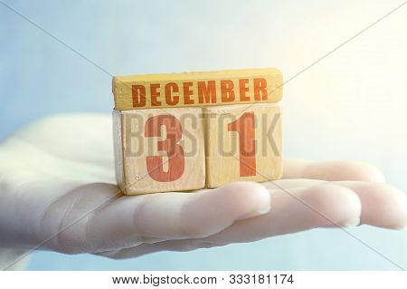 December 31st. Day 31of Month, Handmade Wood Cube With Date Month And Day On Female Palm Winter Mont