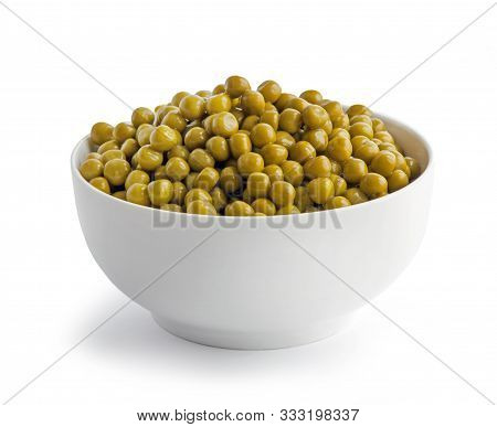 Bowl Of Green Canned Peas Isolated On White Background