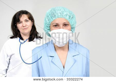 Doctor and nurse  isolated on grey, health photo