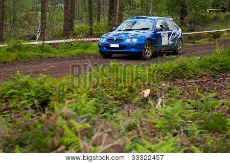 M. Brady Driving Rover Mg