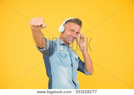 Cool Man Enjoy Music. His Favorite Playlist. Dj Party. Happy Man Dancing Yellow Background. Listen T
