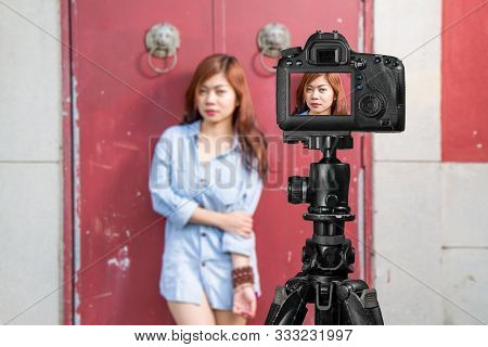 Filipina Female Social Media Sta Front Of Traditional Chinese Door With Ornate Lion Head Knockers, T