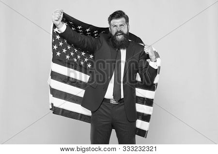 Honour And Glory To My Country. Happy Businessman Holding Old Glory American Flag On Yellow Backgrou